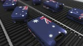 manuseio : Many travel suitcases featuring flag of Australia. Australian tourism conceptual animation