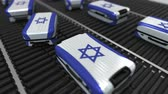 manuseio : Many travel suitcases featuring flag of Israel. Israeli tourism conceptual animation
