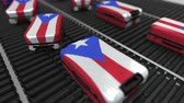 manuseio : Many travel suitcases featuring flag of Puerto Rico on roller conveyer. Puerto Rican tourism conceptual animation Vídeos