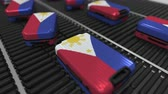 roller conveyor : Many travel suitcases featuring flag of the Philippines on roller conveyer. Tourism related conceptual animation