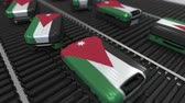 jordanian : Many travel suitcases featuring flag of Jordan on roller conveyer. Jordanian tourism conceptual animation Stock Footage