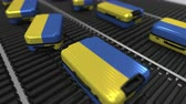 roller conveyor : Many travel suitcases featuring flag of Ukraine on roller conveyer. Ukrainian tourism conceptual animation Stock Footage