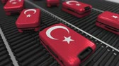 manuseio : Many travel suitcases featuring flag of Turkey on roller conveyer. Turkish tourism conceptual animation Vídeos