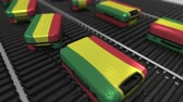 bolivia : Many travel suitcases featuring flag of Bolivia on roller conveyer. Bolivian tourism conceptual animation