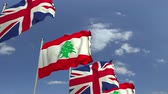 libano : Waving flags of Lebanon and the United Kingdom on sky background, loopable 3D animation