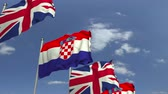 croata : Row of waving flags of Croatia and the United Kingdom, loopable 3D animation Stock Footage