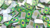 coverage : Pile of SIM cards with flag of Brazil. Brazilian mobile telecommunications related conceptual 3D animation Stock Footage