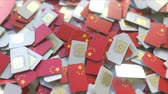 coverage : Pile of SIM cards with flag of China. Chinese mobile telecommunications related conceptual 3D animation