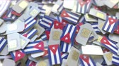 Куба : Multiple SIM cards with flag of Cuba. Cuban mobile telecommunications conceptual 3D animation