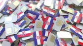 hırvat : Multiple SIM cards with flag of Croatia. Croatian mobile telecommunications conceptual 3D animation