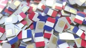 coverage : Pile of SIM cards with flag of France. French mobile telecommunications related conceptual 3D animation Stock Footage