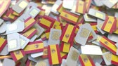 coverage : Multiple SIM cards with flag of Spain. Spanish mobile telecommunications conceptual 3D animation