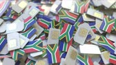 coverage : Pile of SIM cards with flag of South Africa. African mobile telecommunications related conceptual 3D animation