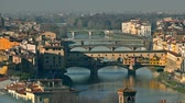riverside : Ponte Vecchio bridge, a major Italian landmark, and the cityscape of Florence, Italy