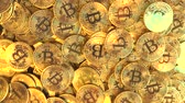 economics : A pile of shiny golden bitcoin tokens or coins, top down view. Cryptocurrency related conceptual animation