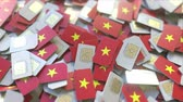 telekomünikasyon : Pile of SIM cards with flag of Vietnam. Vietnamese mobile telecommunications related conceptual 3D animation