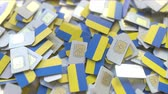 ukrajinec : Pile of SIM cards with flag of Ukraine. Ukrainian mobile telecommunications related conceptual 3D animation