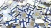 telecomunicações : SIM cards with flag of Finland. Finnish cellular network related conceptual 3D animation