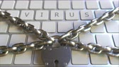 proibir : VIRUS text on the keys of a keyboard with padlock and chains. Restriction related conceptual 3D animation