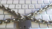 restringido : SEO word on the keyboard with padlock and chains. Conceptual 3D animation