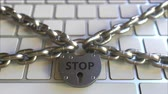 restringido : Chains and padlock with STOP text on the computer keyboard. Conceptual 3D animation