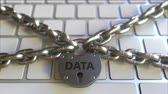 restringido : Chains and lock with DATA text on the computer keyboard. Conceptual 3D animation