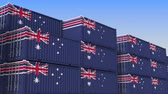 ausztrál : Container yard full of containers with flag of Australia. Australian export or import related loopable 3D animation