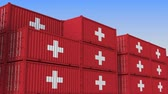 ターミナル : Container terminal full of containers with flag of Switzerland. Swiss export or import related loopable 3D animation