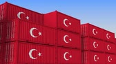 türk : Container yard full of containers with flag of Turkey. Turkish export or import related loopable 3D animation Stok Video