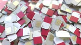 hücresel : Many SIM cards with flag of Malta. Maltese mobile telecommunications related 3D animation Stok Video