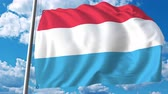 şaft : Flying flag of Luxembourg on sky background. 3D animation