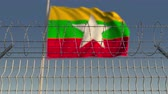 şaft : Waving flag of Myanmar behind barbed wire fence. Conceptual loopable 3D animation