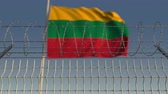 şaft : Waving flag of Lithuania behind barbed wire fence. Conceptual loopable 3D animation Stok Video