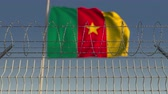 граница : National flag of Cameroon behind barbed wire fence. Conceptual loopable 3D animation