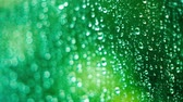 şeffaflık : Raindrops on the window on a rainy day. Close-up racking focus shot