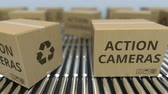 roller conveyor : Cartons with action cameras on roller conveyors. Loopable 3D animation