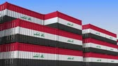 eksport : Container terminal full of containers with flag of Iraq. Iraqi export or import related loopable 3D animation