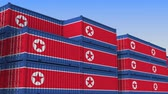 eksport : Container yard full of containers with flag of North Korea. Export or import related loopable 3D animation