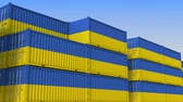 eksport : Container yard full of containers with flag of Ukraine. Ukrainian export or import related loopable 3D animation Wideo