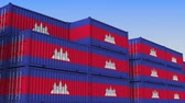 eksport : Container yard full of containers with flag of Cambodia. Cambodian export or import related loopable 3D animation