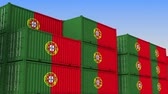 eksport : Container yard full of containers with flag of Portugal. Portuguese export or import related loopable 3D animation Wideo