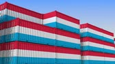 eksport : Container yard full of containers with flag of Luxembourg. Luxembourgian export or import related loopable 3D animation Wideo