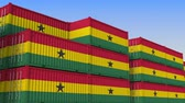 ithalat : Container yard full of containers with flag of Ghana. Ghanaian export or import related loopable 3D animation Stok Video
