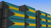 eksport : Container yard full of containers with flag of Bahamas. Bahamian export or import related loopable 3D animation Wideo