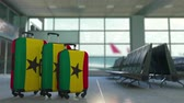 emigración : Travel suitcases with flag of Ghana. Ghanaian tourism conceptual 3D animation Archivo de Video