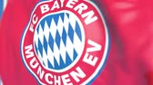 챔피언 : Waving flag with Bayern Munchen football team logo, close-up. Editorial loopable 3D animation 무비클립