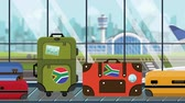 kolotoč : Suitcases with flag stickers on baggage carousel in airport, close-up. Tourism in South Africa related loopable cartoon animation