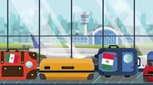 istek : Suitcases with Mexican flag stickers on baggage carousel in airport, close-up. Travel to Mexico related loopable cartoon animation Stok Video