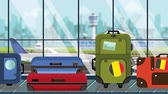 belga : Suitcases with Belgian flag stickers on baggage carousel in airport, close-up. Tourism in Belgium related loopable cartoon animation