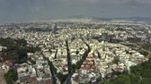 atina : Aerial view to the west of the cityscape of Athens involving Sanctuary Of Zeus, Greece Stok Video